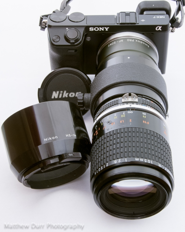 Shown with hood, extension tube, and cap