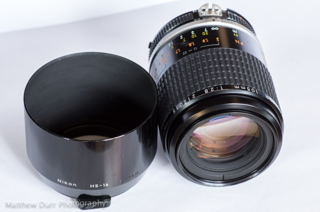 Pictured here with the hood at the lens' side, the 105mm micro is noticeably smaller