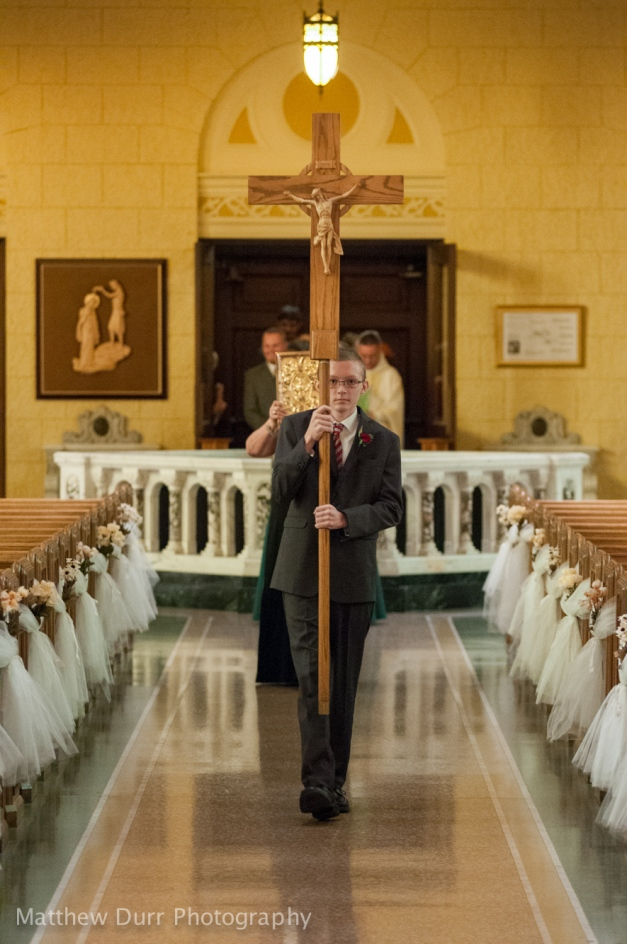 Cross Bearer Nikon 116mm, ISO 3200, f/2.8, 1/100